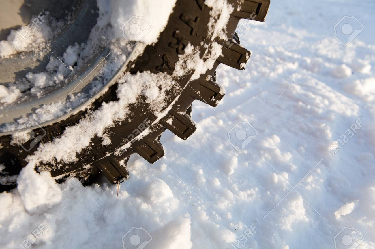 winter tire with snow Stock Photo - 21539668