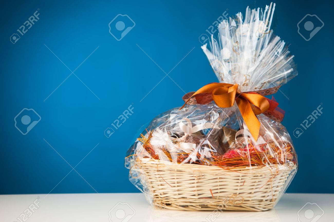 gift basket against blue background - 27018271