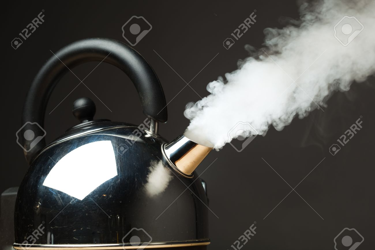 boiling kettle with dense steam stock photo picture and royalty