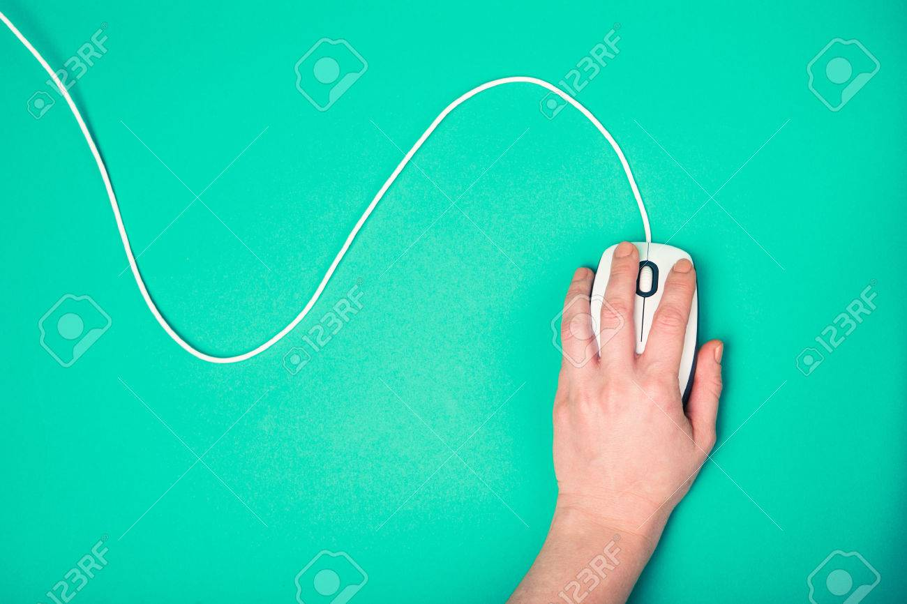 hand on computer mouse, emerald background - 37777085