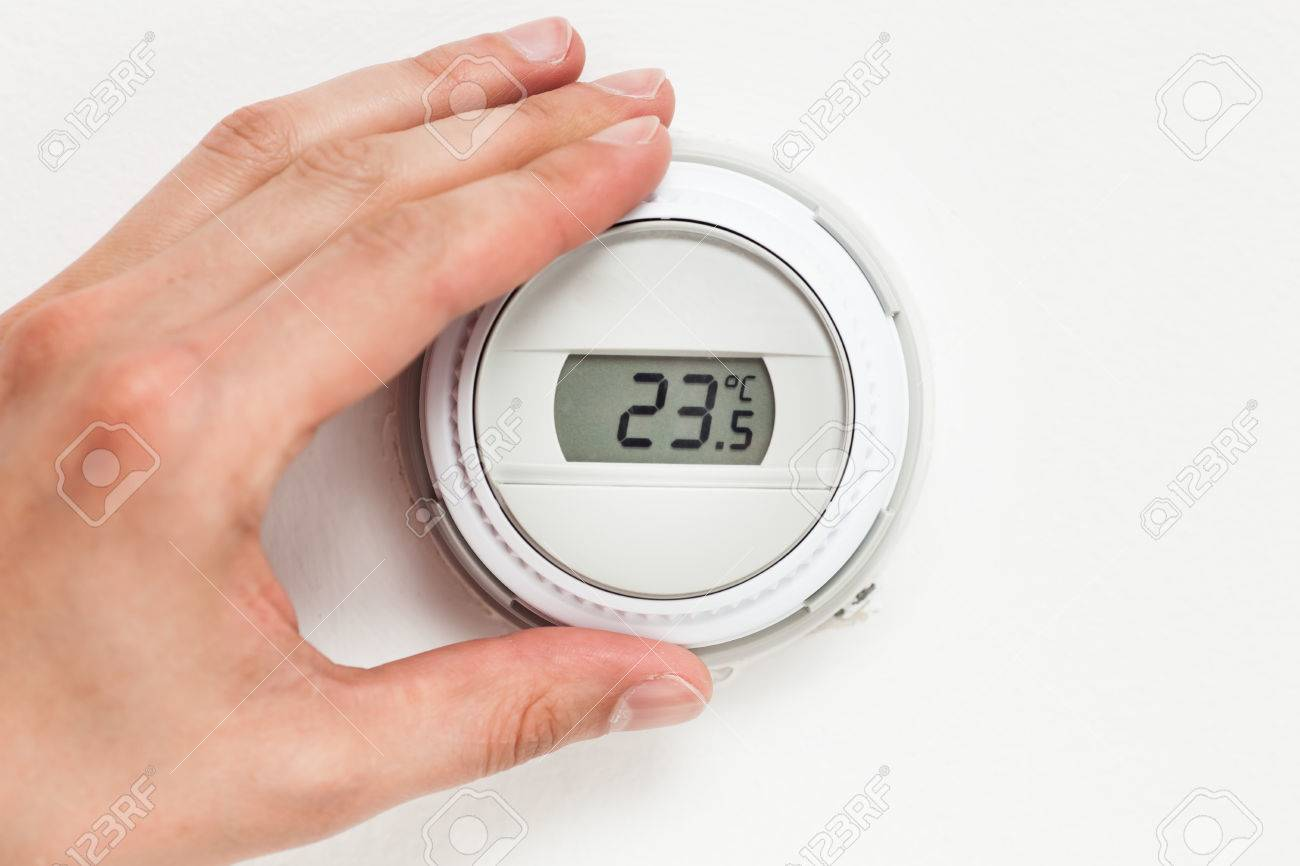 digital climate thermostat controlling by hand - 41086181