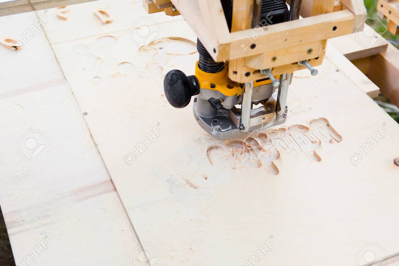 wood milling machine in action - 42779219