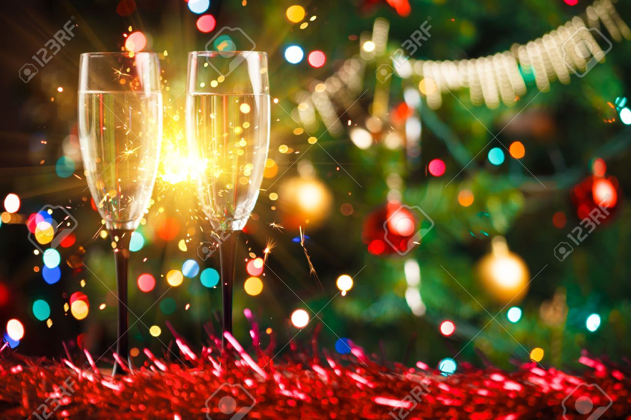 pair of champagne glasses and sparkler christmas tree ornament as the background stock photo - Christmas Tree Ornament
