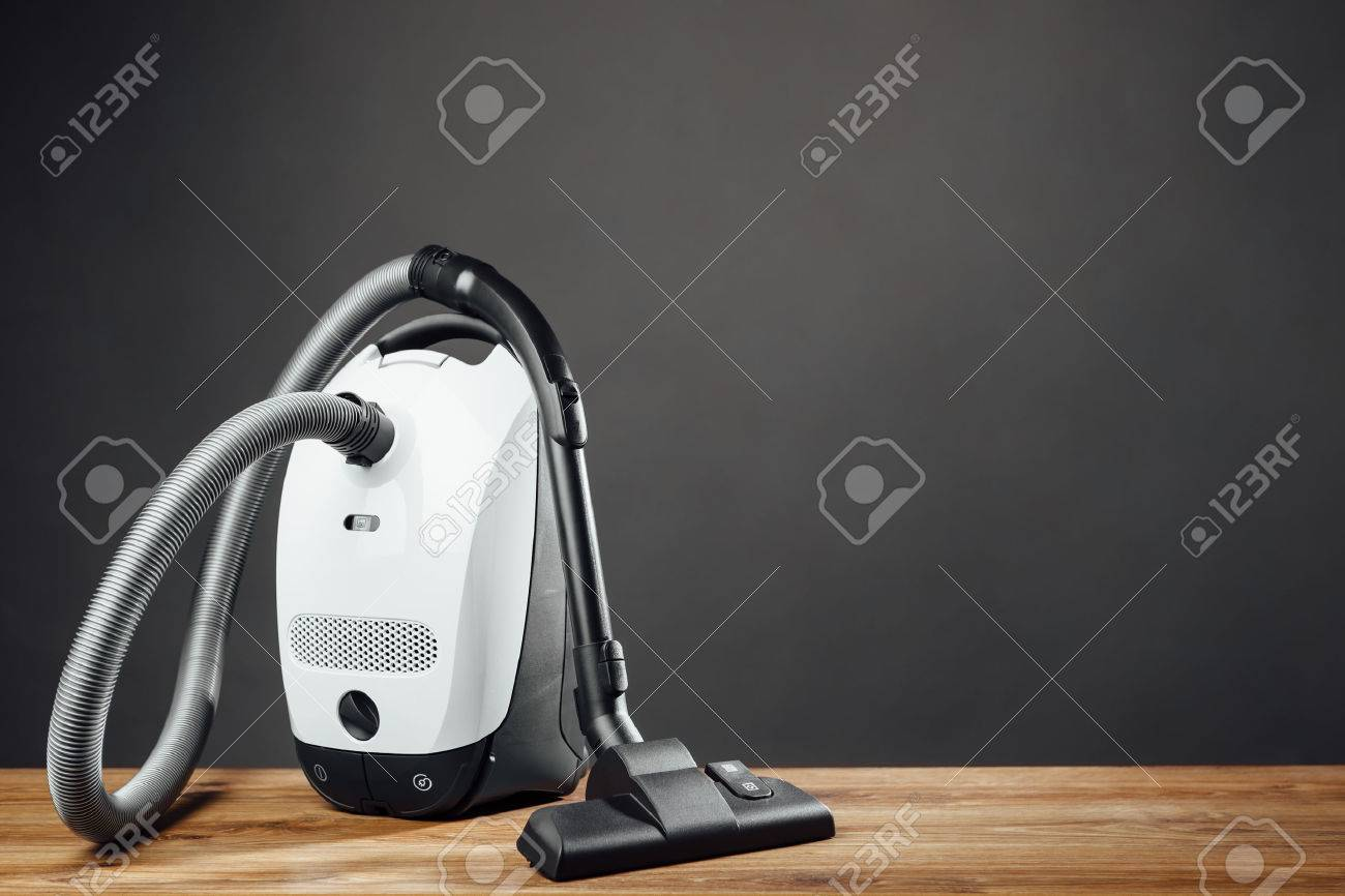 vacuum cleaner on grey background - 53615135