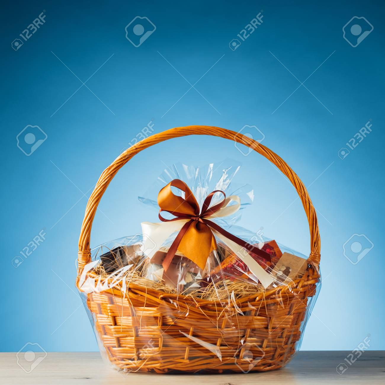 gift basket on blue background - 80703531