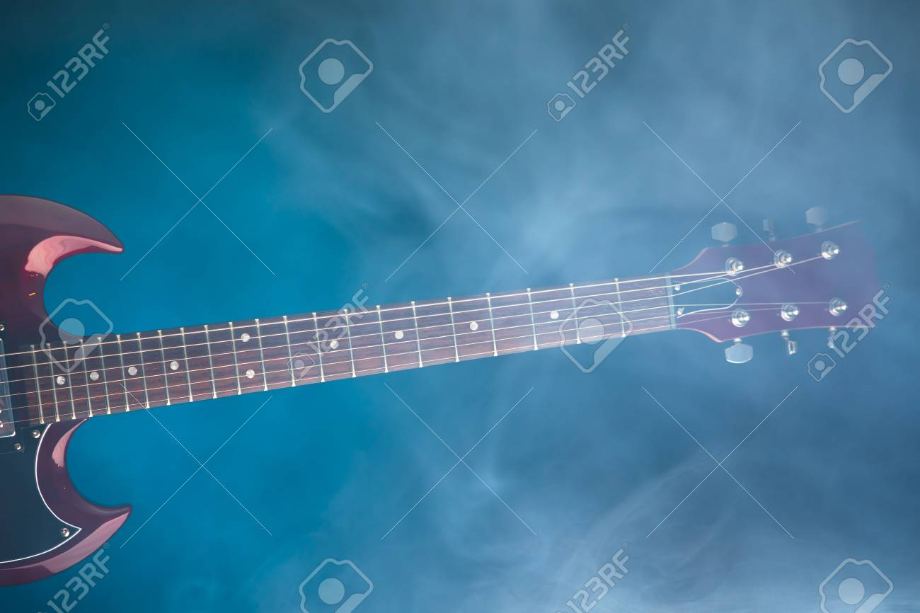 electric guitar in smoke, blue background - 88978154