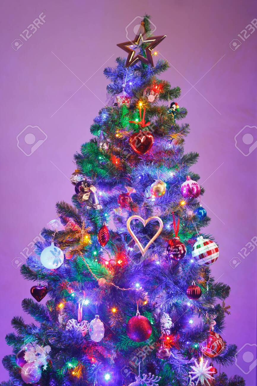 super popular af148 88ca7 Christmas tree with multicolor led lights and purple background