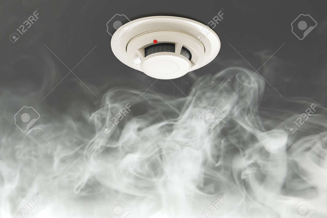 smoke detector on ceiling, fire alarm in action - 166405951