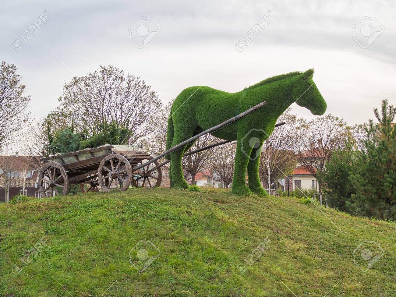 Horse covered with grass with a cart - a creative landscape design Stock  Photo - 91343332 - Horse Covered With Grass With A Cart - A Creative Landscape Design