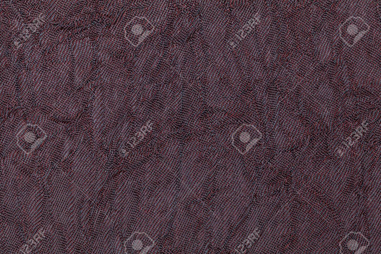 Dark Purple Wavy Background From A Textile Material Fabric With