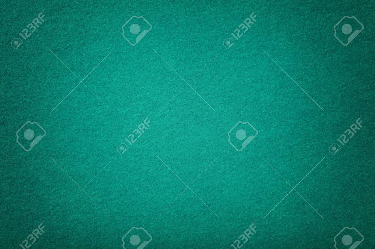 Dark turquoise matte background of suede fabric, closeup. Velvet texture of seamless green woolen felt with vignette. - 125280125