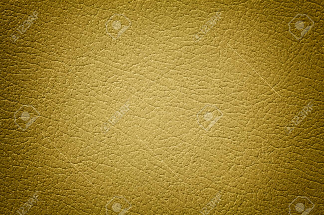 Dark yellow leather texture background, closeup. Golden cracked backdrop from wrinkle skin, structure of textile with vignette. - 129690123