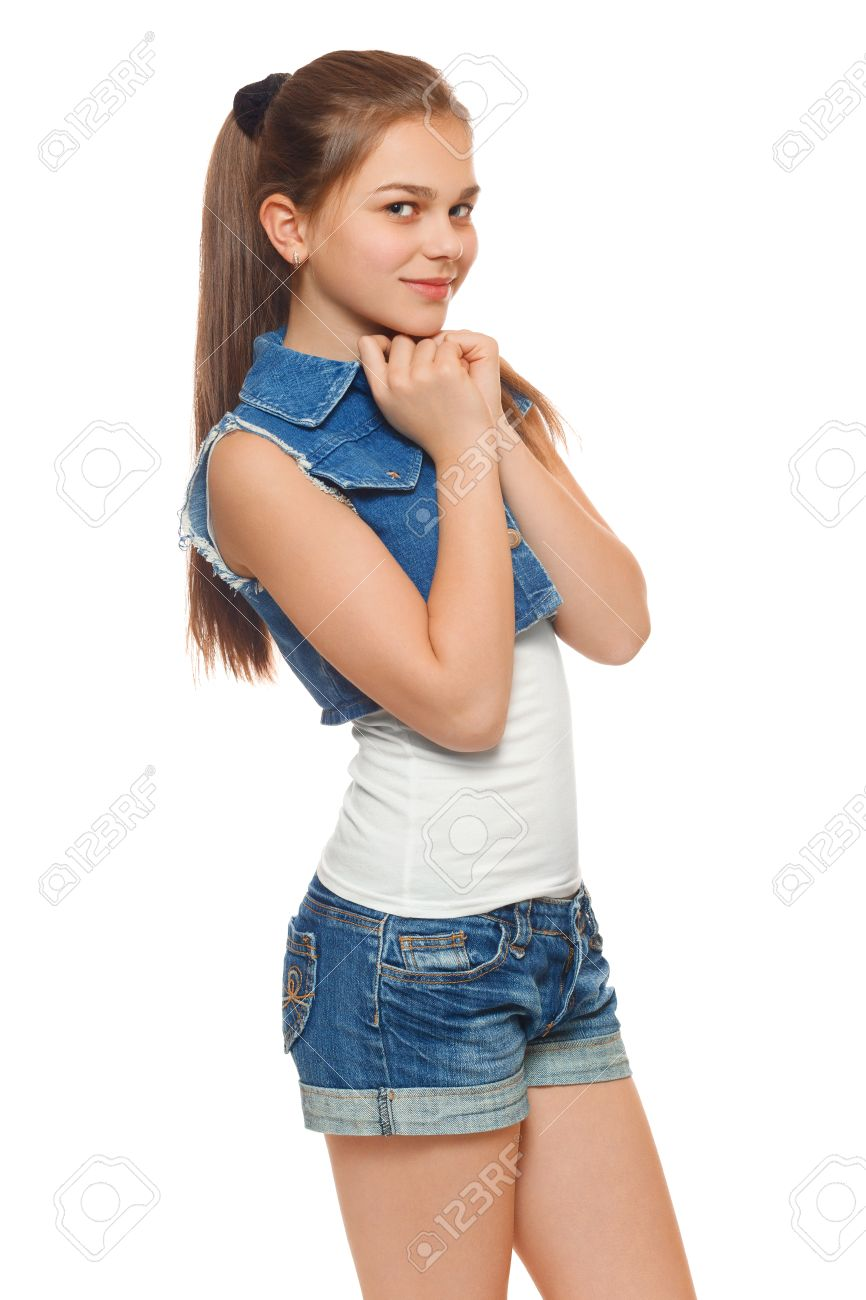Stock Photo - Stylish young girl in a jeans vest and denim shorts. Street  style teenager 3d08367d2009