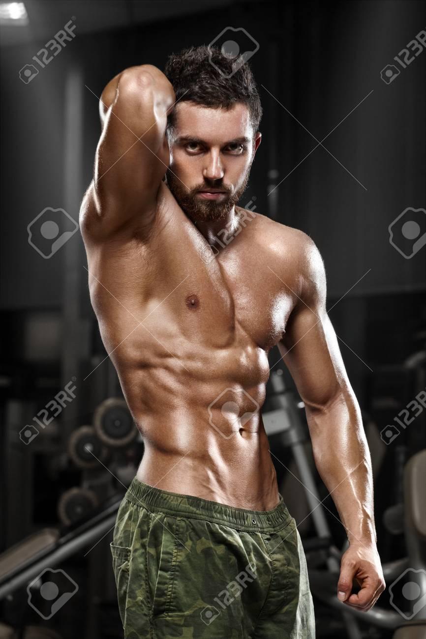 Muscle men posing naked