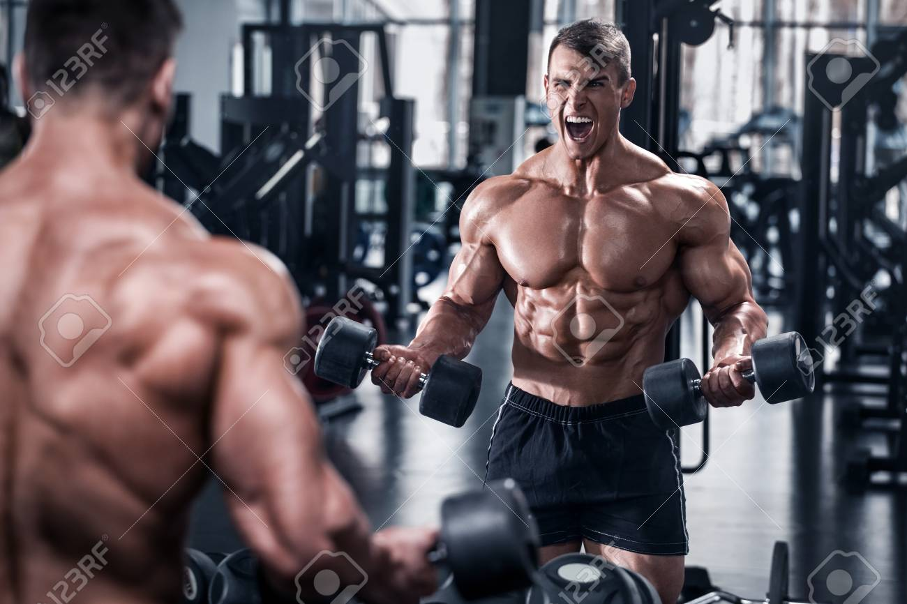 Muscular Man Working Out In Gym, Bodybuilder. Strong Male Abs Stock Photo,  Picture And Royalty Free Image. Image 100408772.