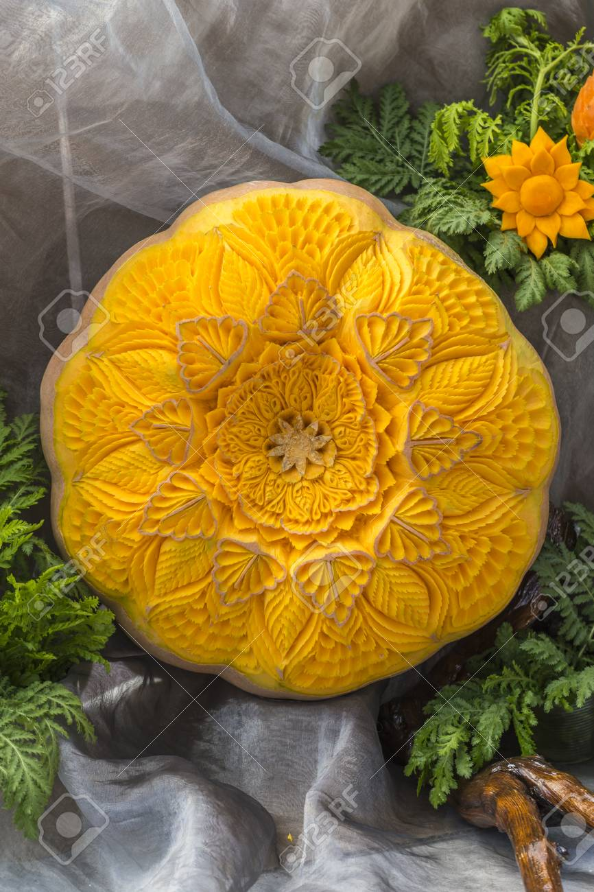 Food carving art decoration made out of pumpkin stock photo