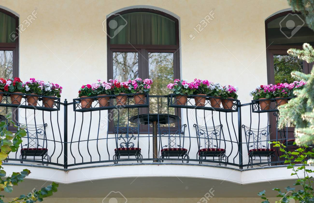 Street cafe, table and flowers Stock Photo - 17780380