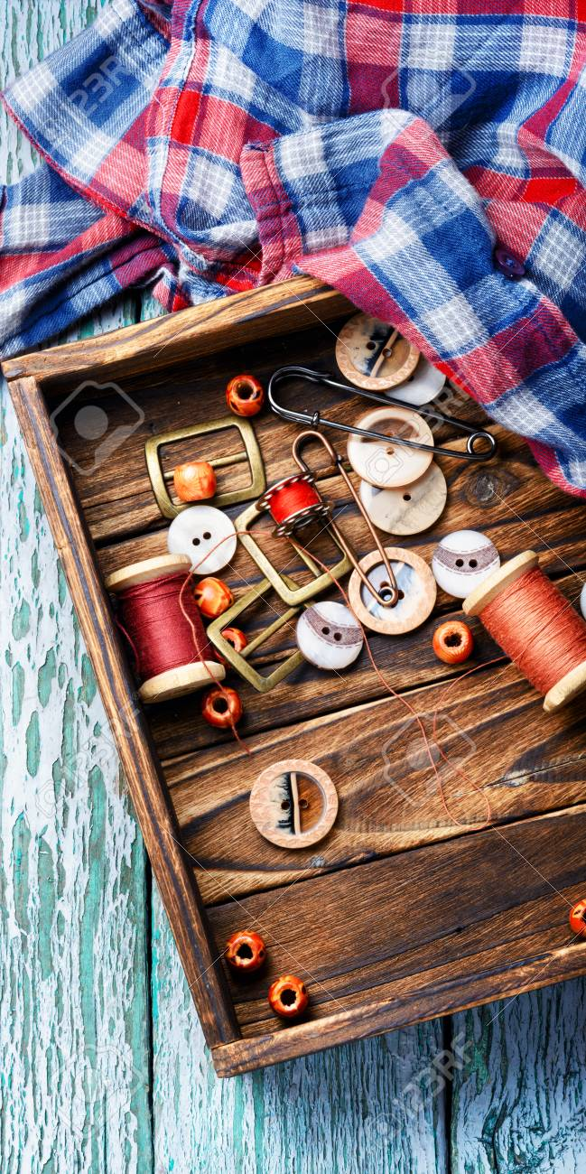 sewing kit from sewing thread, buttons and fabric