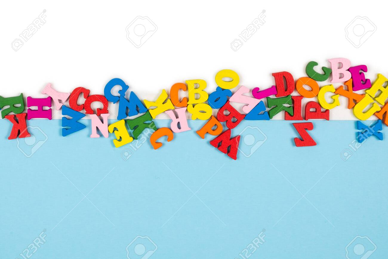 Row of multicolored letters isolated on a white background. Copy space. Frame. - 139807823