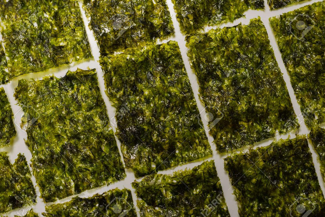Tasty nori seaweed isolated on white background. - 158336133