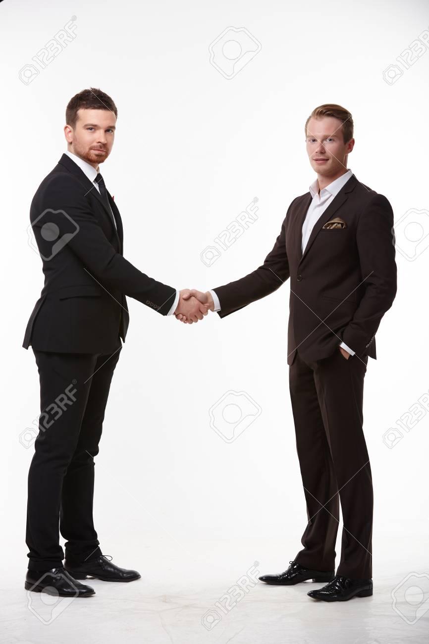 handshake of two businessmen - 37870250