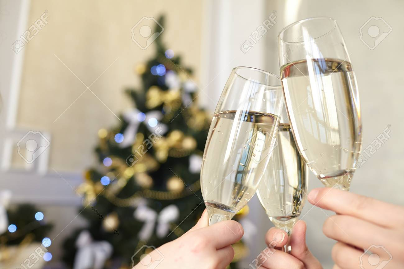 Glasses of champagne in female hands on Christmas party - 43954118