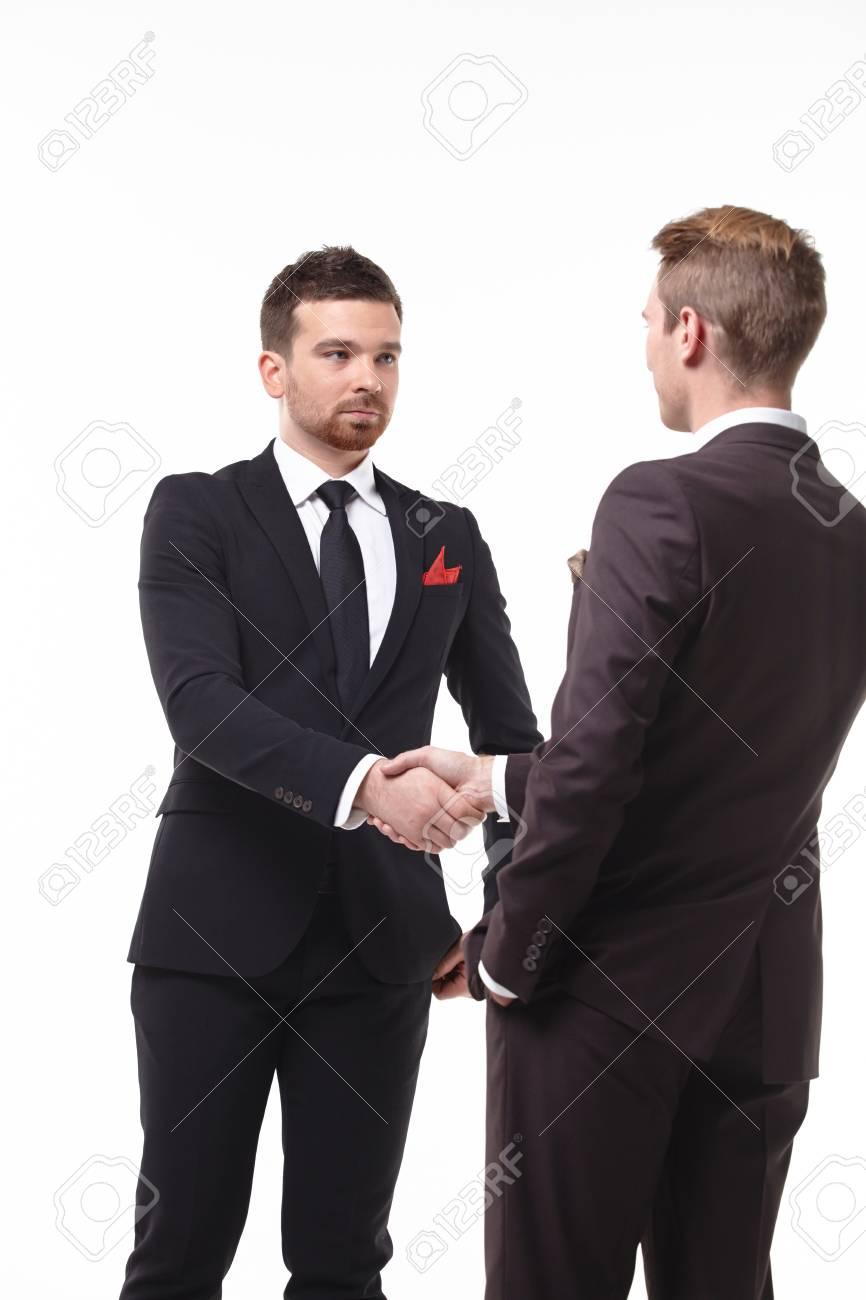 two businessmen shake hands - 46488006