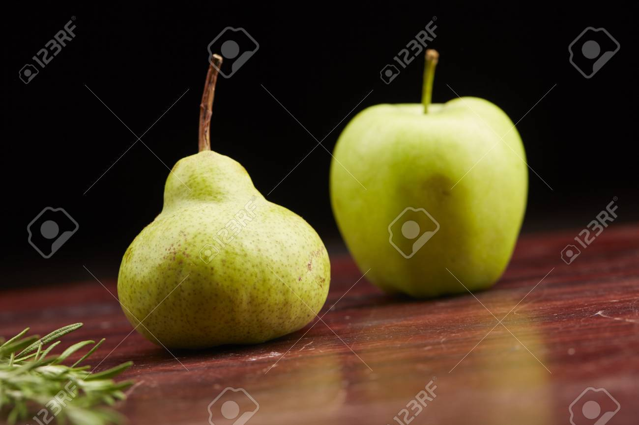 pear and apple on the table - 82921373