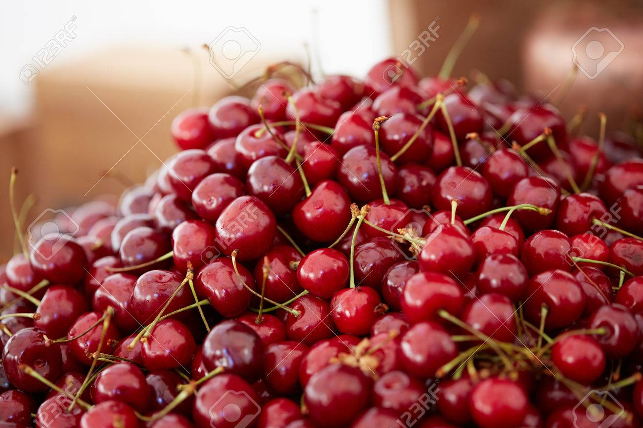 delicious, beautiful cherry in a large bowl - 82921377