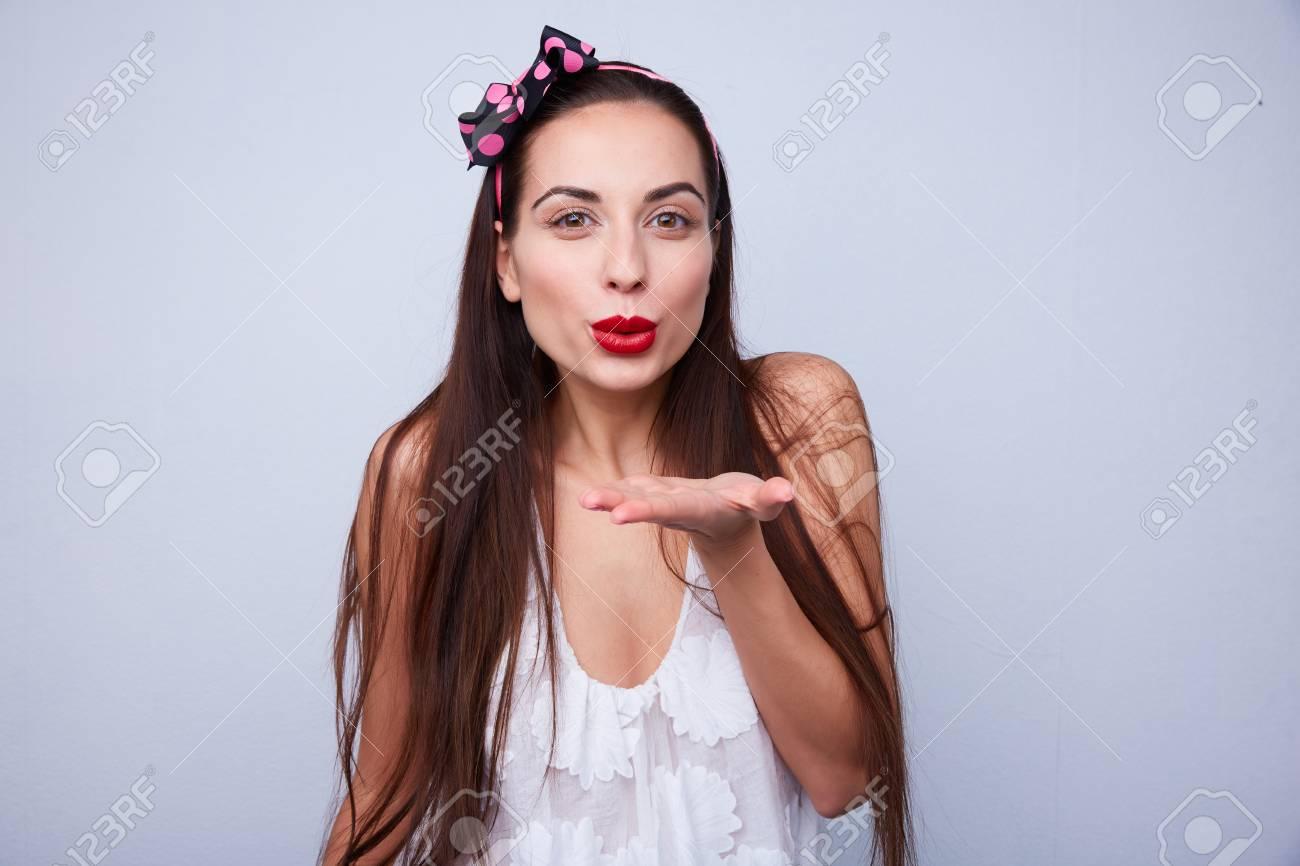 beautiful girl sends an air kiss - 82921379