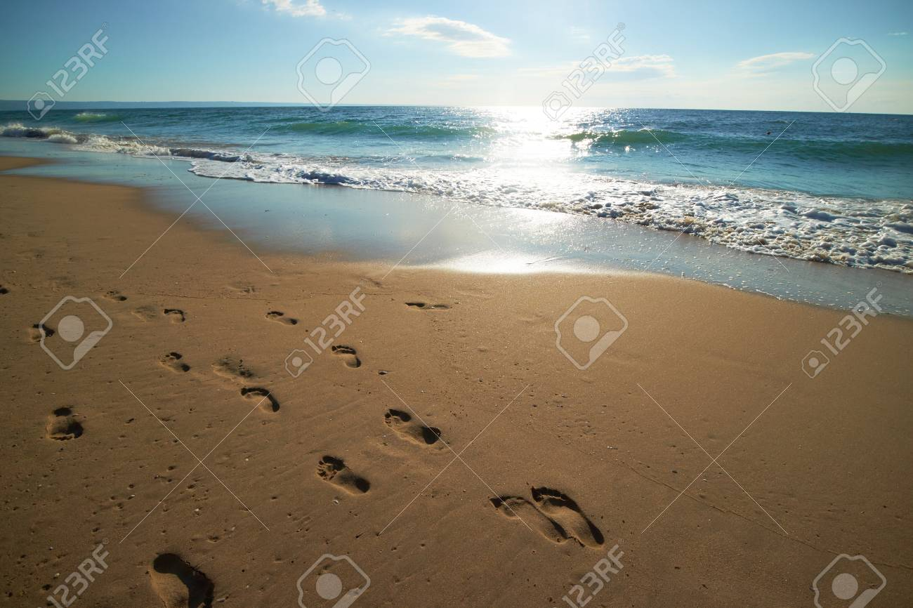 footprints in the sand on the beach - 82921392
