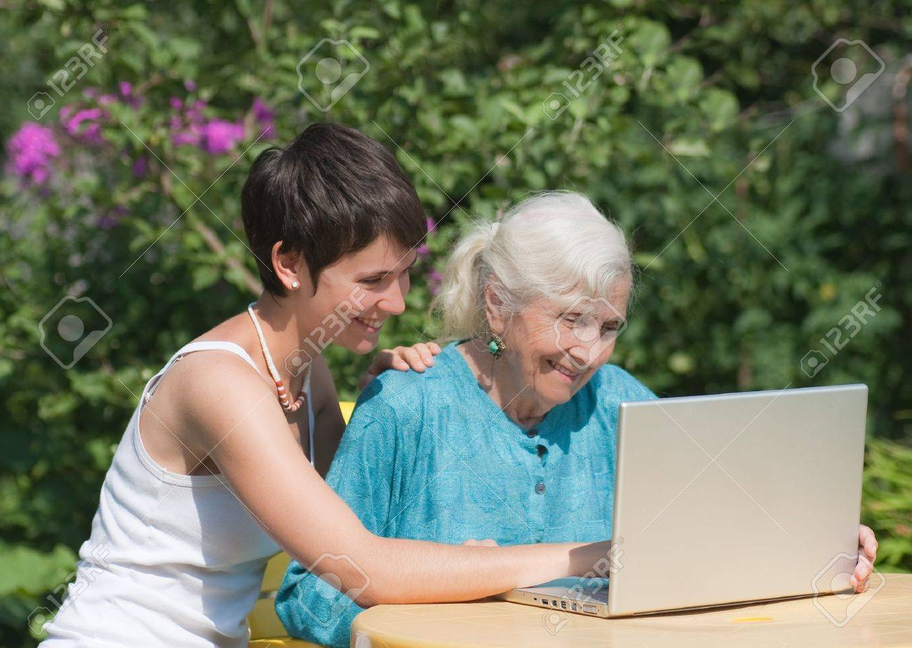 Grandmother and granddaughter with laptop Stock Photo - 12759415