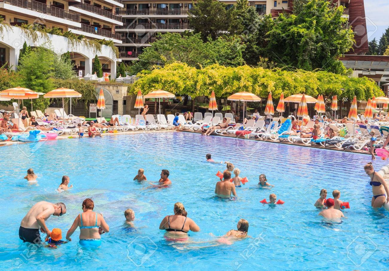 Hotel pool with people  People Swim In Pool Of Hotel Flamingo Grand Hotel At Summer Sunny ...