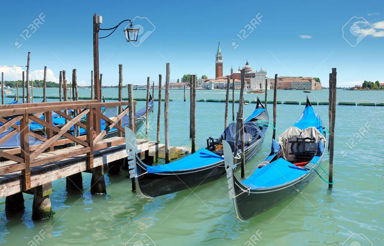 Two gondolas on the San Marco canal and Church of San Giorgio Maggiore in Venice, Italia. Stock Photo - 7579798