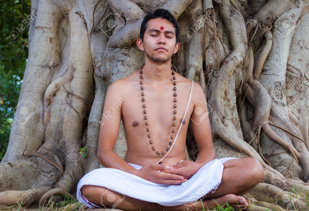 A Young Hindu Brahmin Sits In Meditation Under A Banyan Tree ...