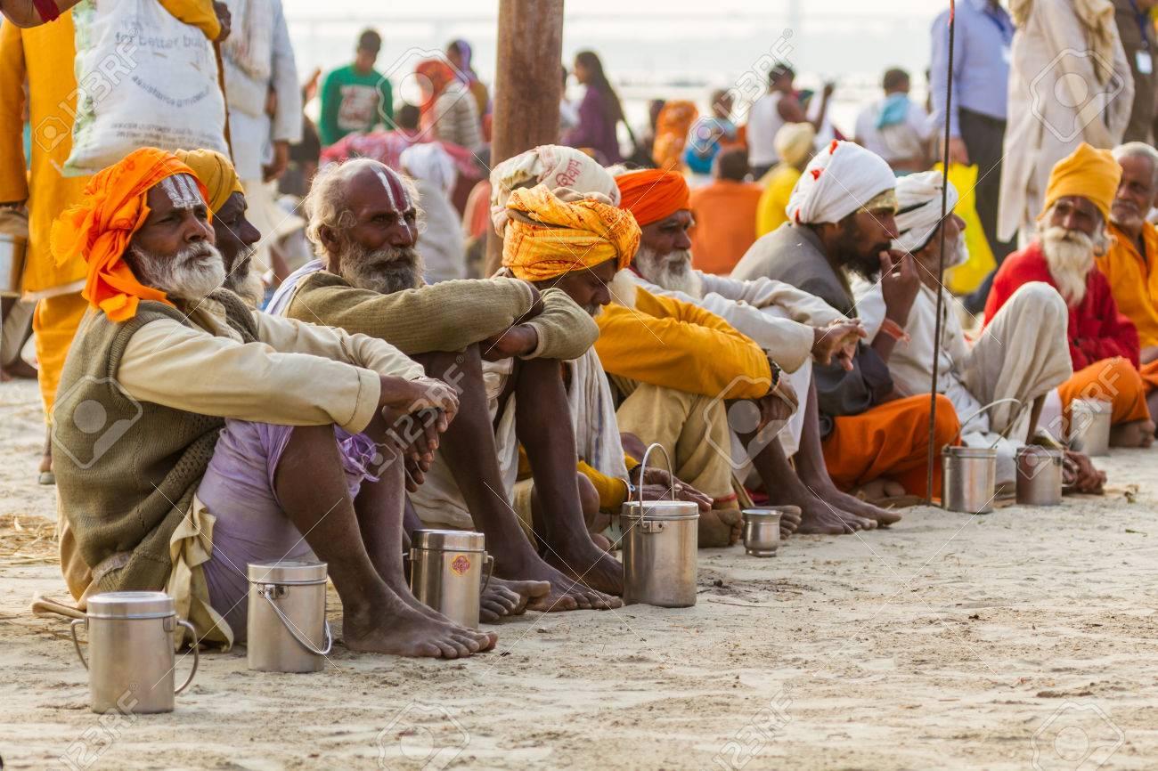 ALLAHABAD, INDIA - FEB 14 - Hindu Sadhus wait for free food distribution