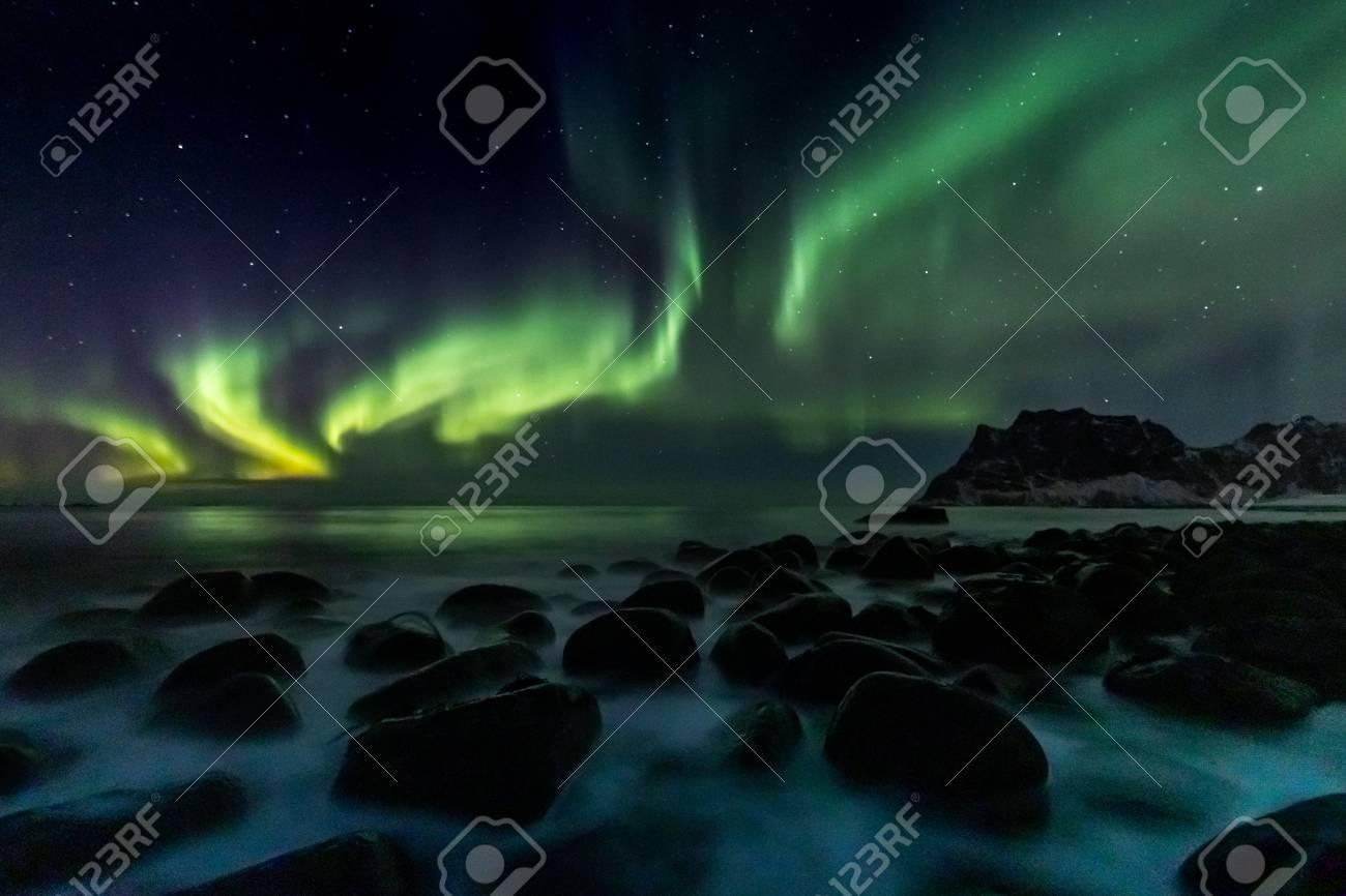 Beautiful green Northern Lights at Utakleiv Beach on the Lofoten Islands in Norway - 125955669