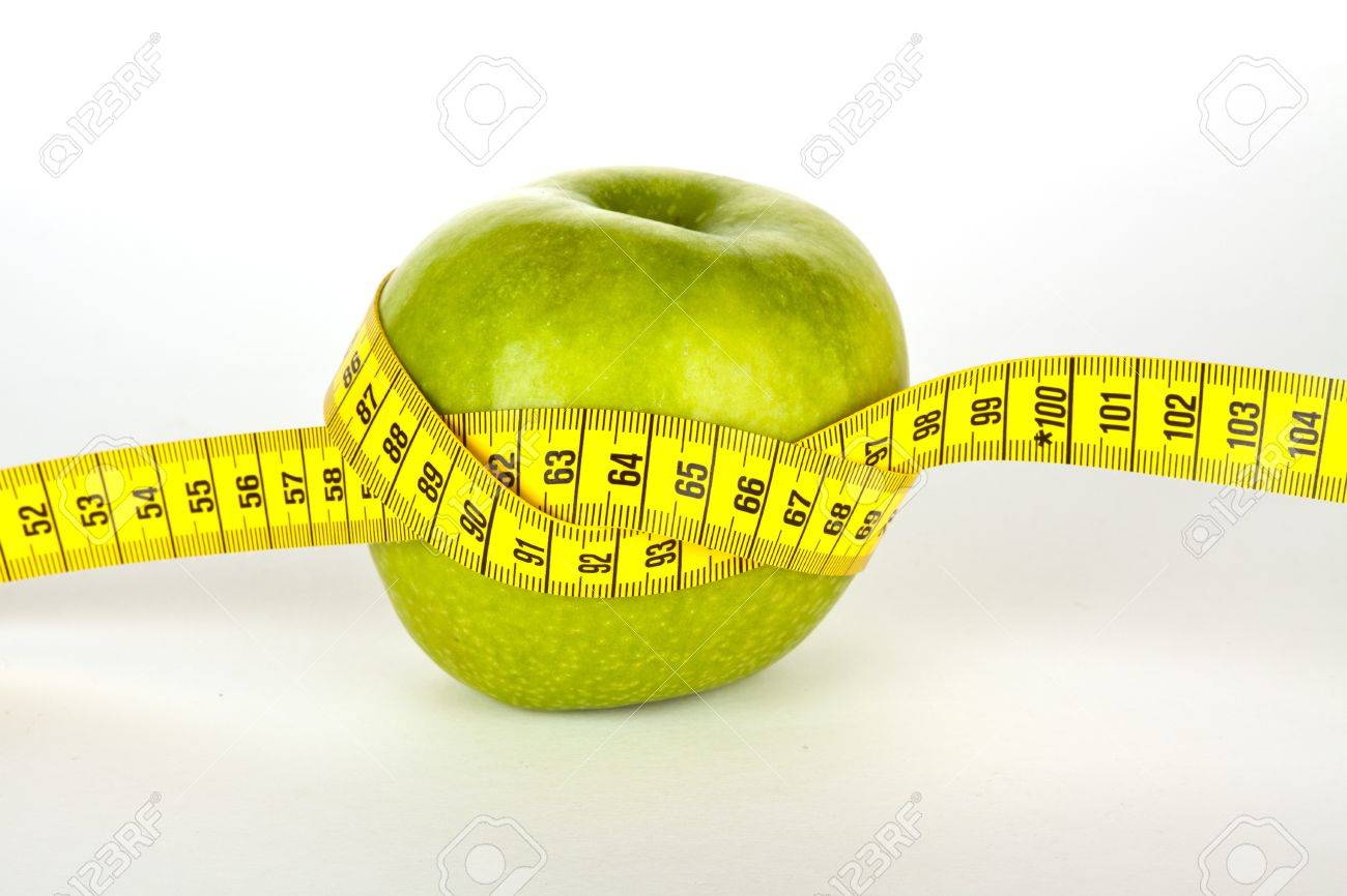 fresh green apple with yellow measure tape Stock Photo - 12752621