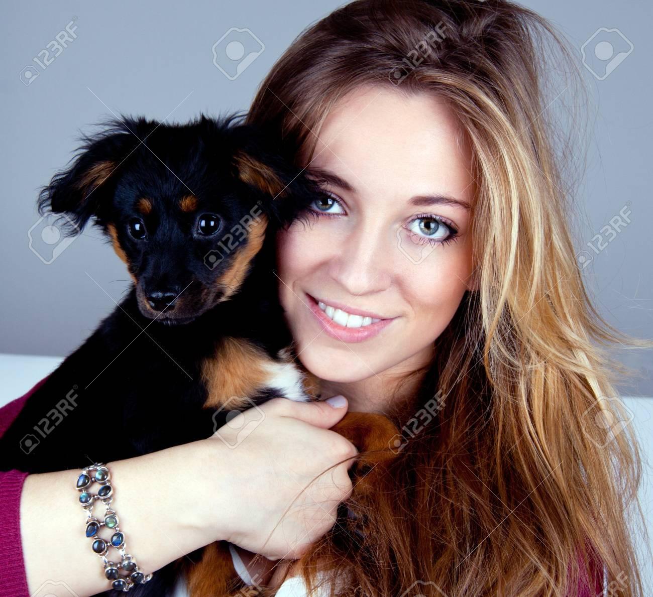 young beatiful girl with a cute little dog having fun Stock Photo - 13089363
