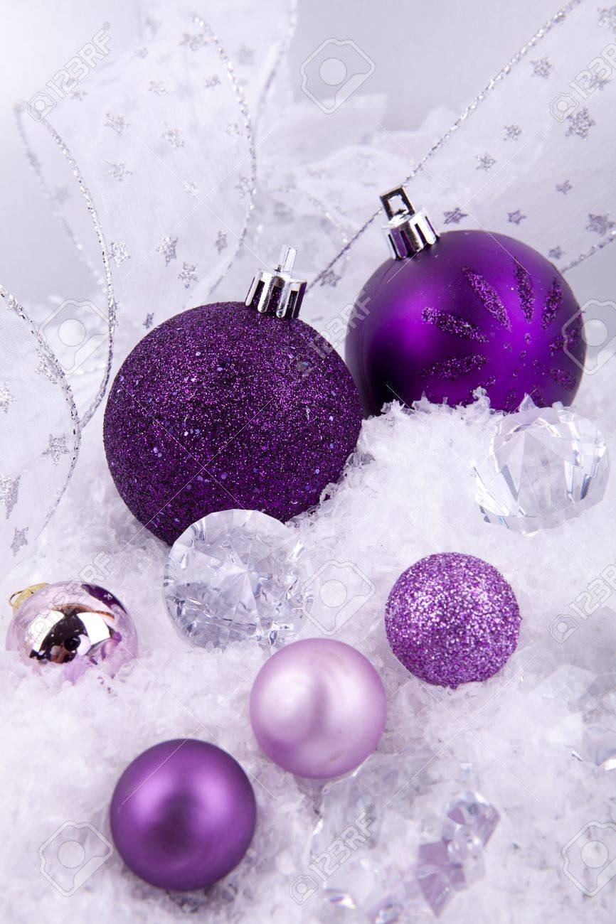 Purple and silver christmas decorations - Beautiful Christmas Decoration In Purple And Silver On White Snow Sparkle Stock Photo 14644663