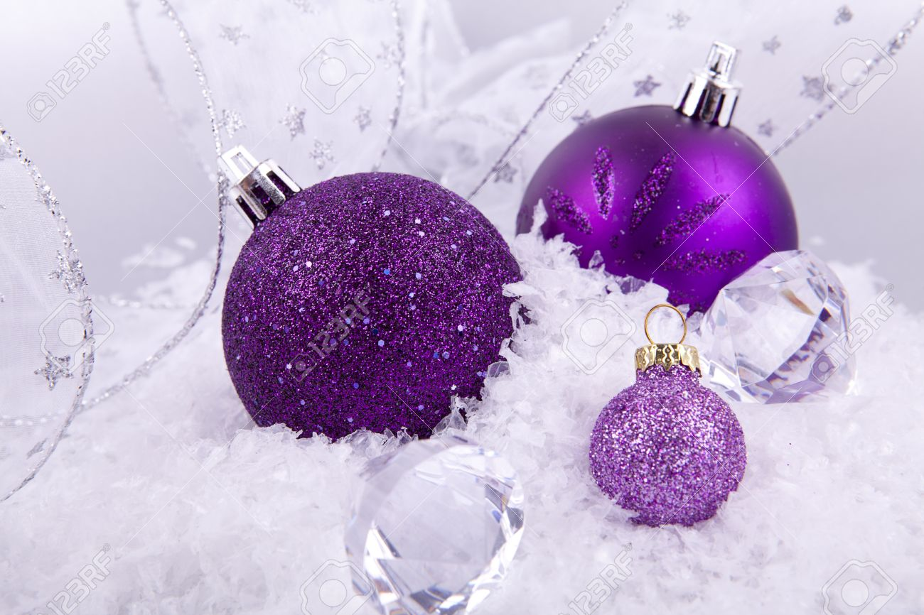 beautiful christmas decoration in purple and silver on white snow sparkle stock photo 14644581