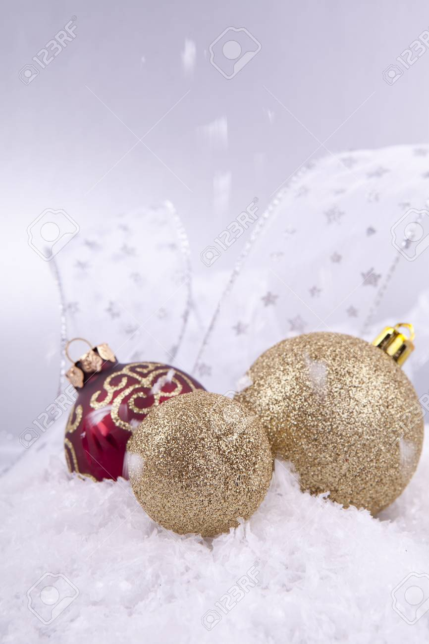 beautiful gold and red christmas decoration on white snow sparkle Stock Photo - 14644574