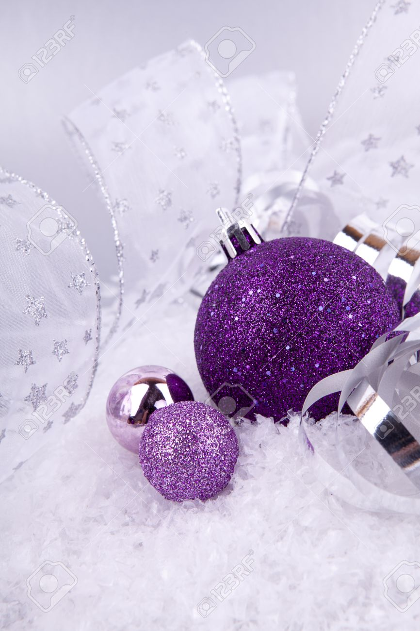 beautiful christmas decoration in purple and silver on white snow sparkle stock photo 14644529