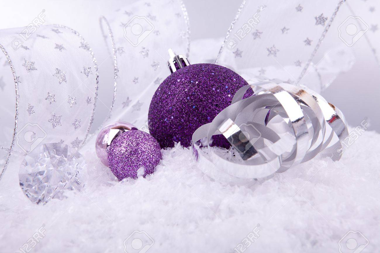 Purple silver and white christmas decorations - Beautiful Christmas Decoration In Purple And Silver On White Snow Sparkle Stock Photo 14645280