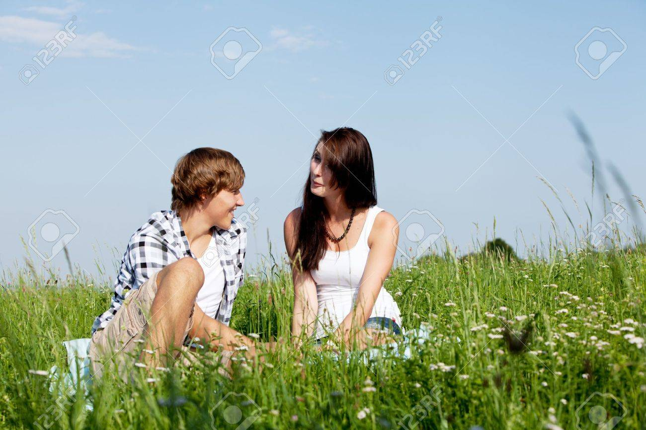 young couple outdoor in summer on blanket in love Stock Photo - 14796243