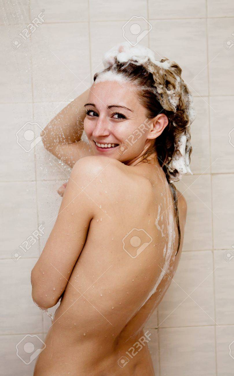 young brunette woman is taking shower and washing hair Stock Photo - 16129788