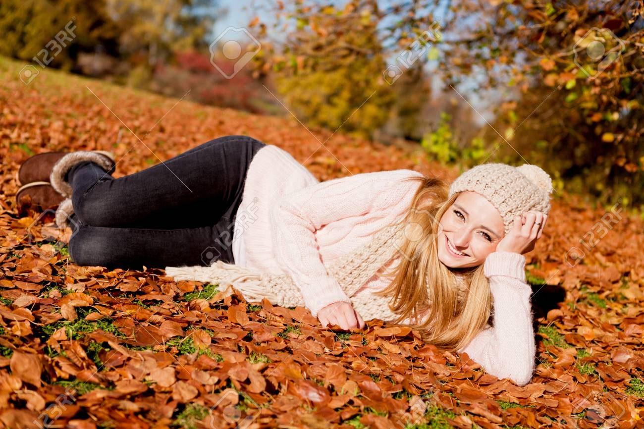 young woman outdoor in autumn with cap and warm clothes relaxing Stock Photo - 17283256