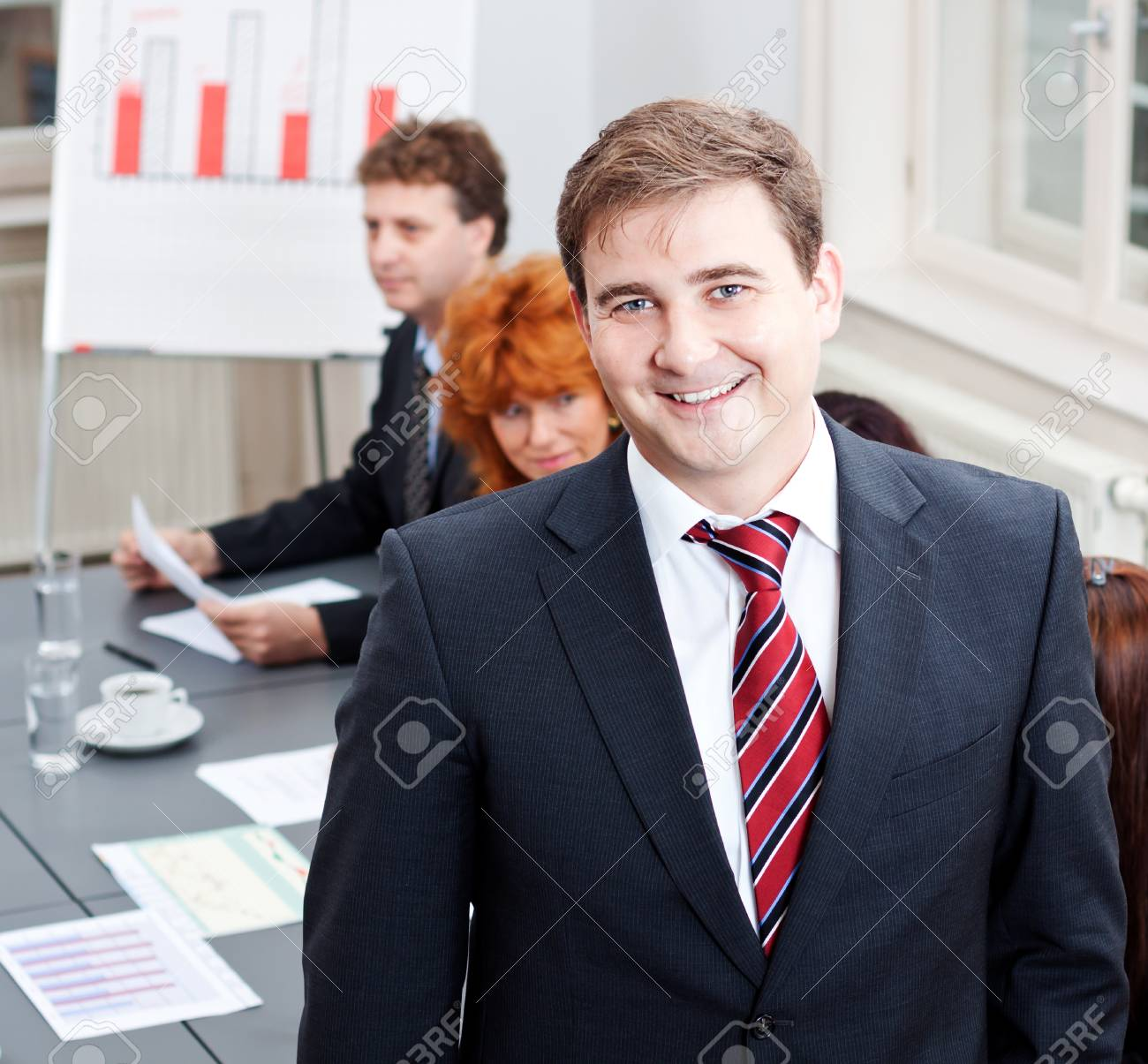 successful business smiling man portrait at office with team in background Stock Photo - 17449158