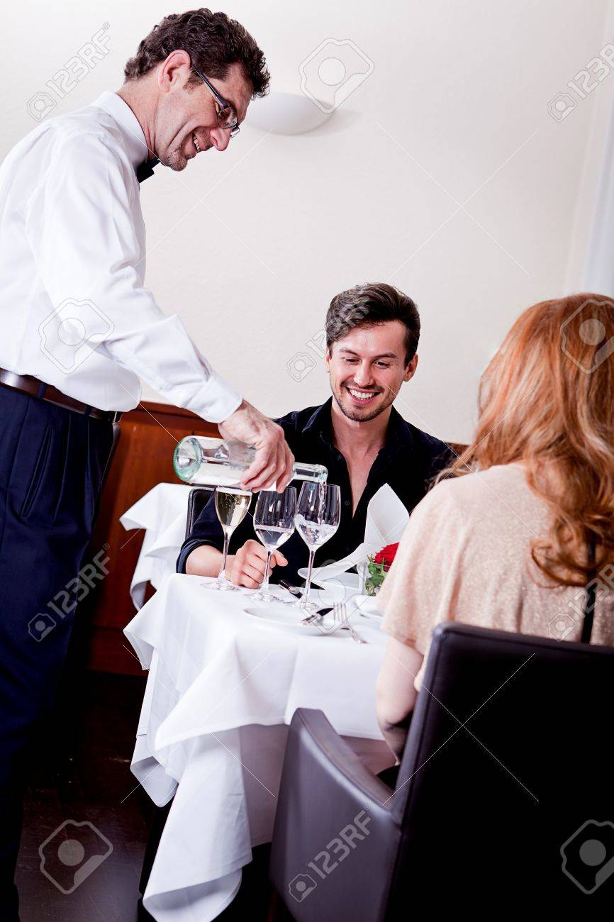 Man And Woman For Dinner In Restaurant Waiter Serving Mineral Stock Photo Picture And Royalty Free Image Image 18137633