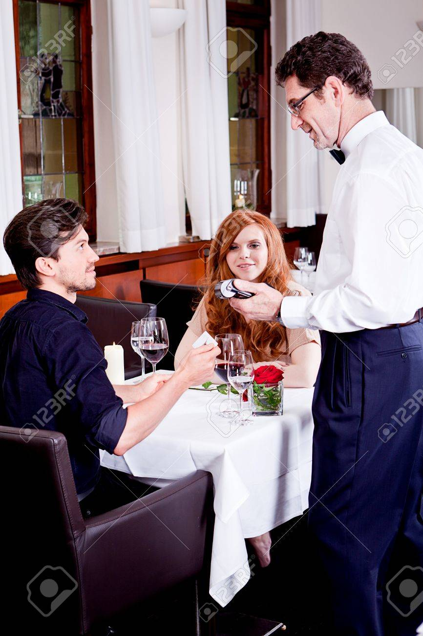 dinner in restaurant man and woman pay by credit card Stock Photo - 18137800